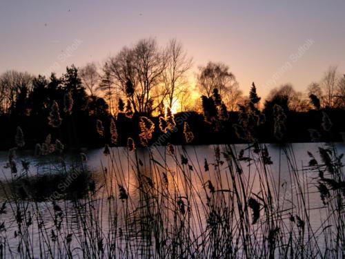 Sunset over Needham Lake by Hazel Calver
